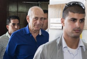 Former Israeli Prime Minister Ehud Olmert (C) leaves Tel Aviv's district court after a hearing in his trial for corruption linked to a major property development on May 13, 2014. Olmert, 68, who was convicted on March 31, 2014 on two charges of taking bribes was sentenced to six years in prison and a fine of a million shekels ($290,000/210,000 euros) over his involvement in one of the country's worst-ever corruption scandals. AFP PHOTO / POOL / JACK GUEZ